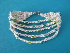Wind Rose Fiber Studio: Search results for summer cotton crochet bracelet Crochet Bracelet Tutorial, Crochet Bracelet Pattern, Crochet Beaded Bracelets, Bead Crochet, Crochet Patterns, Crochet Jewellery, Tutorial Crochet, Beaded Necklaces, Crochet Gratis