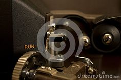 Close-up of a 16mm Eiki projector.