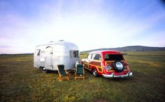 1950 Ford Woody parked next to a 1952 Airstream Cruisette
