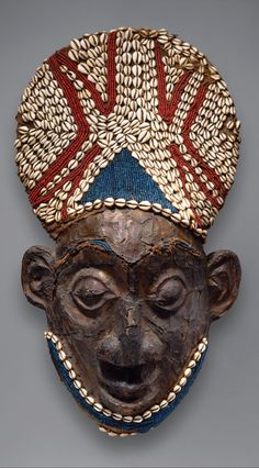 Africa   Helmet mask from the Bamum kingdom, Grassfields region, Cameroon   Wood, copper, glass beads, raffia and cowrie shells   ca. prior to 1880