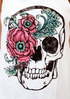 Nice flower. Skulls are great tattoos!