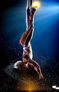 Singer Pink makes quite the splash at the 52nd annual Grammy Awards by performing suspended above the audience.