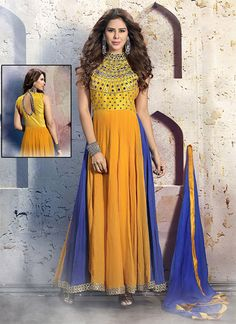 coloured in beautiful blue and yellow shade pure georgette with mirror and zari work that complements the anarkali suit. ₹11,429.00