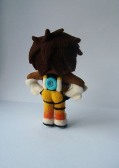 Tracer inspired by Overwatch ~(˘▾˘~) The toy is very dense, it will not be deformed (DRY CLEAN ONLY) Check more overwatch plush toys here: ✦ Tracer https://www.etsy.com/listing/465635160 ✦ Widowmaker https://www.etsy.com/listing/464752833 ✦ Sombra https://www.etsy.com/listing/480534226 ~Details~ ✶Dimensions: 12cm ✶Material: wool, hypoallergenic sintepon ✶Needle felted ✶ Quality ✔ ✶Main store page https://www.etsy.com&#x...