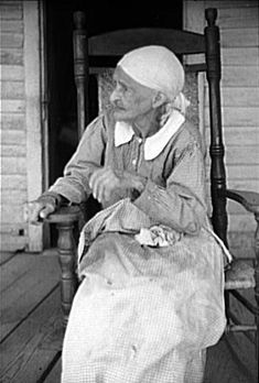 This is a photograph of an ex-slave mulatto woman. The photograph was taken in 1941 in Greene County Georgia. the name of the woman is not known.