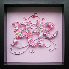 """Quilling:  A colorful quilled name (""""Jade"""") on beautiful scrapbook paper, framed.  -  megacrafty.com"""