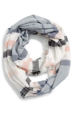 Stripes of rich texture and soft color pattern this breezy infinity scarf that adds the perfect finishing touch to any spring look.