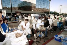 Medical personal work a triage unit outside Olive View Medical Center in Sylmar, California, to help some of the dozens of people injured in the earthquake, on January 17, 1994. (AP Photo/Douglas C.Pizac)