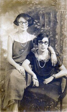 a found photo? pearls, glasses, wrist watches, and is that a cigarette holder? Compared to my Mom's dated photos, it's early-to-mid 1930's