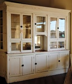 vintage merchant's cabinet.  I wonder if my talented cabinet maker could duplicate this for my kitchen?  Gorgeous!