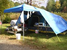 Really like this set-up... tent, canopy, and tarp. Picture only. 30'x20?