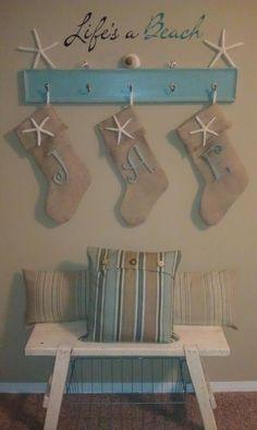 Coastal Christmas stockings all hung in a row Coastal Christmas Decor, Nautical Christmas, Tropical Christmas, Coastal Decor, Christmas Crafts, Christmas Decorations, Beach Christmas Trees, Beach Decorations, Purple Christmas