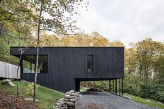 This Wood-Clad Home Is Built Into a Serene Mountain Slope - Photo 1 of 16 - Supported on thin columns, the main volume hovers above the graveled entry, reaching out into the surroundings. House On The Rock, House In The Woods, Beautiful Architecture, Modern Architecture, Minecraft Mountain House, Clad Home, Modern Mountain Home, Villa, Forest House
