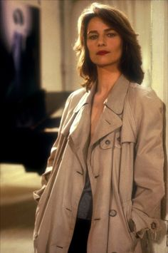 Charlotte Rampling wearing a trench coat