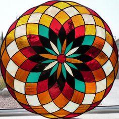 Round stained glass mandala sun catcher.. $145.00, via Etsy. SO AMAZING