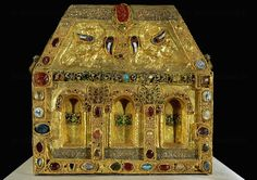 Pippin's reliquary, or the Reliquary of the Circumcision 9th-11th century. Reverse side with birds (eagles? doves?) with enamelled wings; in the center of the roof an antique gem of cornelian representing Apollo.
