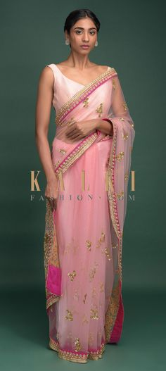 Buy Online from the link below. We ship worldwide (Free Shipping over US$100)  Click Anywhere to Tag Blush Pink Saree In Net With Sequins And Zari Embellished Floral Buttis Online - Kalki Fashion Blush pink saree in net with sequins and zari embellished floral buttis.It comes with bubble gum pink border with gotta lace, zardozi and sequins embroidered floral border.