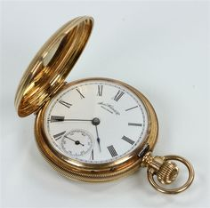 "14K yellow gold hunter case pocket watch, ""American Watch Co. / Waltham,"" engraved with flowers on front and back, 1 1/2"" dia (case), approximately 57 grams TW."