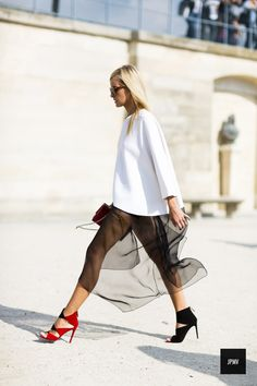 White knit over sheer black skirt and statement heels