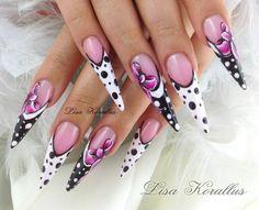 Fun with Bows and polka dots. #polkadots #blackandwhitenails #bows #stilettos #gelnails #nailart #handpaintednails #naildesign #nails #lisakorallus #liquidglamour #nailpictures