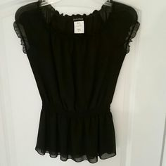 Secret Charm top Worn only a couple of times. In excellent condition. No wear/tear/defect, etc. Fully lined. 100% polyester. Made in USA. Elastic at waistline around arms. It's XL for girls and fits small/xtra small size woman. No trades. Happy Poshing. Secret Charm  Tops