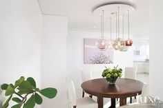 A glass bubble fixture anchors this #Florida home's #dining room.