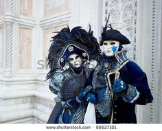 VENICE - MARCH 5: Couple in Venetian costume attend the Carnival of Venice, annual festival starting two weeks before Ash Wednesday and ends on Shrove Tuesday, on March 5, 2011 in Venice, Italy.