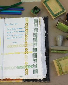 The Guest Book : Custom rubber stamps displayed with the handmade guest book let signees embellish their messages.