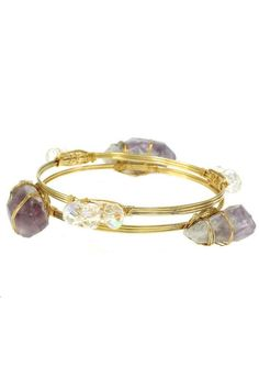 "Two separate wire bangles make up this collection. One is adorned with chunks of genuine amethyst stone, the other with clear, faceted beads. Together they make a stunning fashion statement. The wrapping is done by hand for a creative, boho style. The bangles measure 2.5"" in diameter and are one size fits most. Since these are hand made with genuine stones, please allow for some variation in the size and shape of the amethyst stones.   Genuine Amethyst Bracelet by OORI. Accessories - Jewelry…"