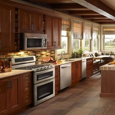 Kitchen. Small Kitchen Layouts designed by l brown wooden kitchen cabinet with white countertop on ceramics flooring plus tiles ceramics backsplash and glass windows on white wooden frame, Magnificent Small Kitchen Layouts Giving Spacious Looks For Kitchen Design