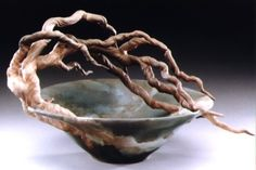 Bonnie Belt creates dramatic tree sculptures from white stoneware. Each piece has realistic branches sculpted from clay and attached to her hand-thrown vessel, bowl, and ginger jar shapes.
