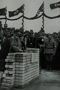 The Führer puts the foundation wall to the meeting house in the Adolf-Hitler-Koog (new land for the Nazis)