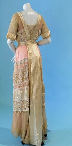 "1910 EXTRAVAGANT DEFINITIVE OF PERIOD DESIGN PINK BEADED/EMBROIDERED SILK GOWN. Gorgeous white seed bead beading with satin band lower skirt, embroidered and couched detailing with row of tiny tassels. A fancy party dress with label ""Jennie & Co, New York. Back"
