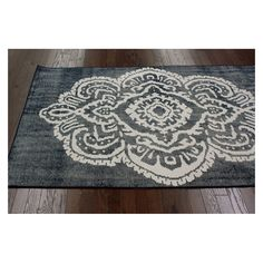 Plain rug, lace curtain as stencil and fabric paint....custom rug.