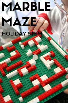 Make a fun LEGO Christmas marble maze! A great holiday STEM activity for kids to play and learn with while stuck inside on a cold winter day! #EngineeringActivities #HolidaySTEM
