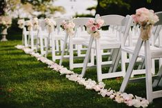 Bouquets in a mason jar tied to the aisle chair.
