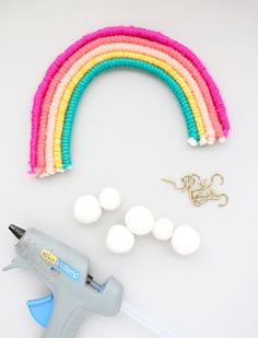 DIY Rainbow Wall Hooks- This is such an easy and cheap home decor idea! I could totally see this in an apartment entryway or small bathroom!