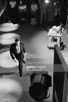 American musician (and actor) Elvis Presley (1935 - 1977) leaves the stage after his performance of 'Hound Dog' on the 'Steve Allen Show,' New York, New York, July 1, 1956. (Photo by Alfred Wertheimer/Getty Images) Credit: Alfred Wertheimer