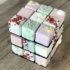 Pastel rubik cake  by @kseniaborilko This rubik cake is very beautiful!!! J'adore les couleurs qui composent ce rubik cake. #rubik #chocolate #chocolat #rubikcake #cupcakes #sprinkles #pink #cake #cakes #white #eiffeltower #paris #cakedesign #cakeart #food #foodporn #meringue #macaron #pastel #amourducake #chic #almond #france #russia #bakery #pastry #patisserie #glamour #photooftheday #artfood