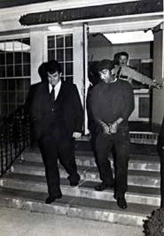 Jim Cummings, then a State trooper, and Melvin Reine under arrest 1984.