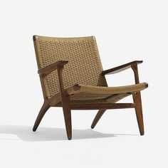 Hans Wegner lounge chair Carl Hansen & Son Denmark, 1951 stained oak, paper cord 28 w x 29 d x 28.5 h inches Signed with partial branded manufacturer's mark to arm: [Designer Hans J. Wegner Made in Denmark Carl Hansen Odense Denmark].