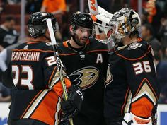 Anaheim Ducks goaltender John Gibson, right, celebrates with defenseman Francois Beauchemin, left, and center Ryan Kesler after the Ducks defeated the Los Angeles Kings 2-1 in an NHL hockey game in Anaheim, Calif., Friday, Jan. 19, 2018. (AP Photo/Alex Gallardo) Ryan Kesler, John Gibson, Nhl Players, Anaheim Ducks, Hockey Games, Los Angeles Kings, Espn, Friday, Celebrities