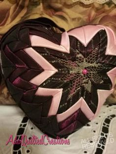 Beautiful quilted heart ornament to accentuate your home decor. I crafted this heart with the utmost love and care and great attention to detail in a smoke free / pet free environment, using three different fabrics. Quilted with pink satin combined with mauve taffeta and lace.