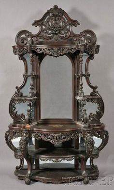 http://photo.foter.com/photos/pi/244/victorian-rococo-revival-carved-rosewood-etagere-with-serpentine-frame-carved-in-high-relief-with-roses-an-c-scrolls-mirrored-back-possibly-alexander-roux-new-york-c-1850-1860.jpg