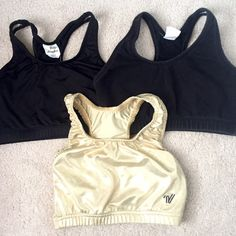 Bundle of Sports Bras Bundle of sports bras. Two black and one gold. 2 Varsity brand and 1 Body Wrappers brand. All are size M. Can be sold separately, just ask! Smoke free home. Varsity Intimates & Sleepwear Bras