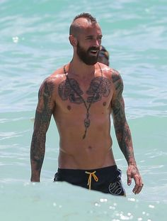 Raul Meireles Tattooed Portuguese soccer star Raul Meireles cools off in the ocean with his wife Ivone while vacationing in Miami, Florida o...
