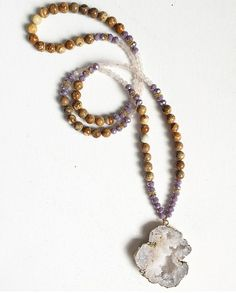 This stunning one of a kind beaded druzy necklace is constructed from 8mm Picture Jasper, 4mm faceted Rose Quartz, and a large white Quartz Druzy Geode Slice and gold pendant, with purple faceted Czech crystal rondelle and gold accents. It will make quite the boho statement when wearing layered or wearing alone! Please check out my other long beaded pendant necklaces here --------> https://www.etsy.com/shop/FlowersInMyHairShop?ref=hdr_shop_menu&section_id=19523824  I also do custom orders…