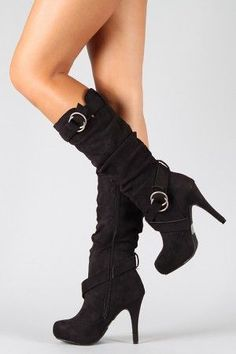 Black knee high boots with straps and heel