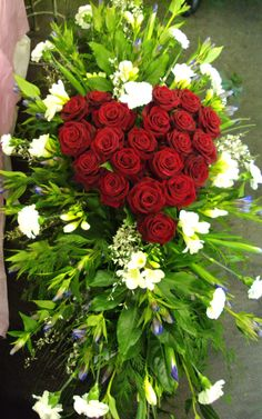 coffin spray with heart made of roses                                                                                                                                                                                 More