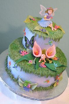 This was a fairy themed baby shower cake. The cake is iced in whipped cream and all the accent work is in buttercream and fondant. The fairy cake topper is plastic. Baby Cakes, Baby Shower Cakes, Girl Cakes, Cupcake Cakes, Fairy Garden Cake, Garden Cakes, Pretty Cakes, Beautiful Cakes, Fairy Birthday Cake